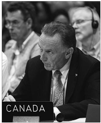 Canadian Environment Minister Peter Kent, glowering menacingly. Photo credit: Rajesh Jantilal, AFP, Getty Images, File, Edmonton Journal